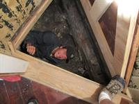 Inspector in crawl space.