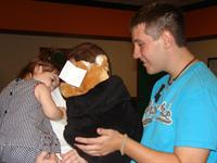 4-H'er Andrew LeBlanc gets a smile out of a young military kid with an Infant Hero Pack