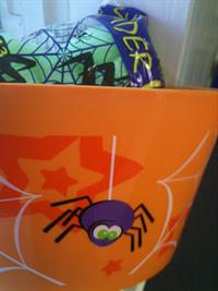 Image of sweets in Halloween container