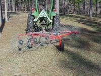 Wheel-type pine straw rake