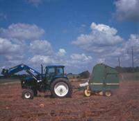 Using hay baler to pick up plastic mulch