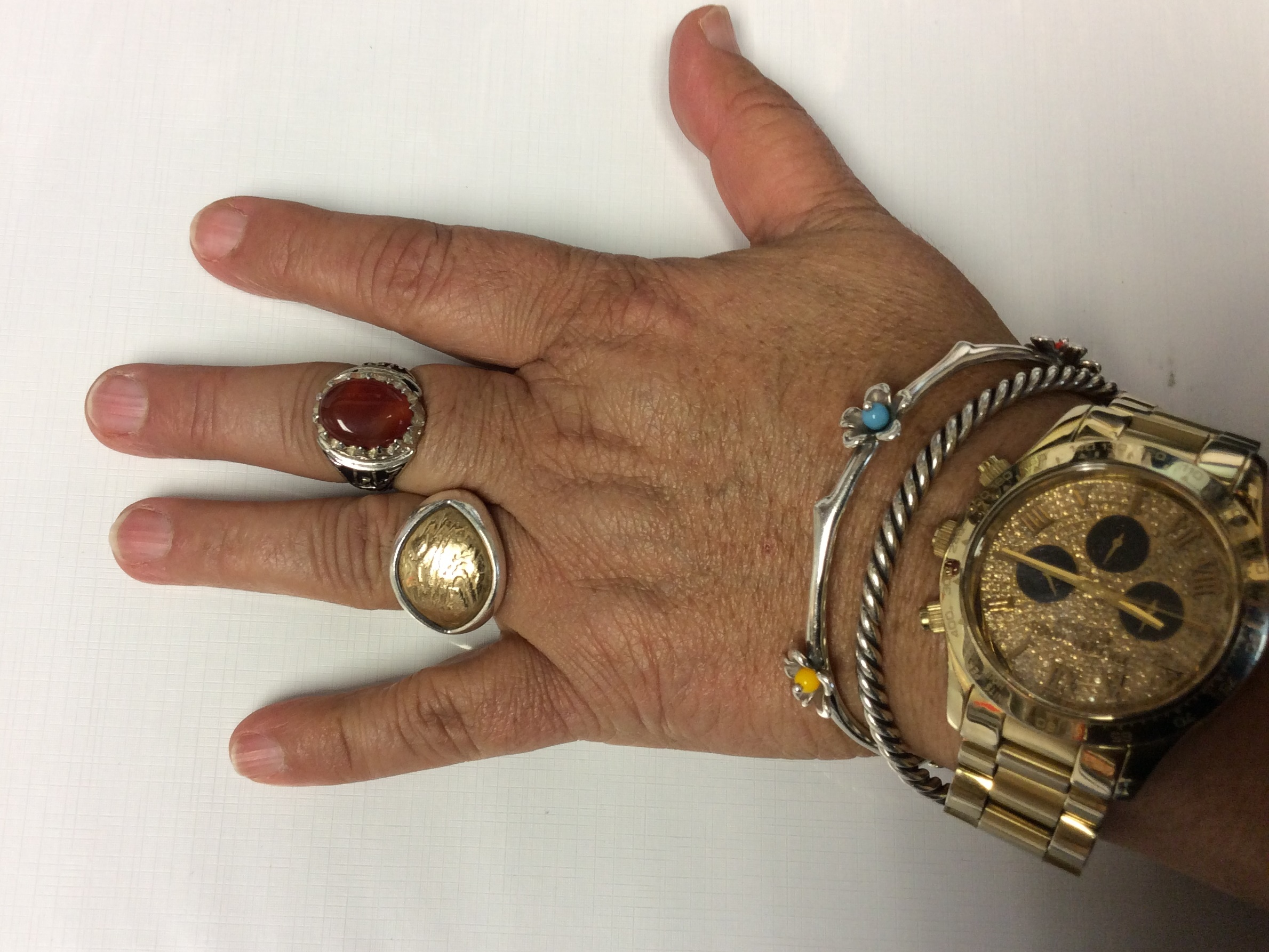Hand with multiple rings on