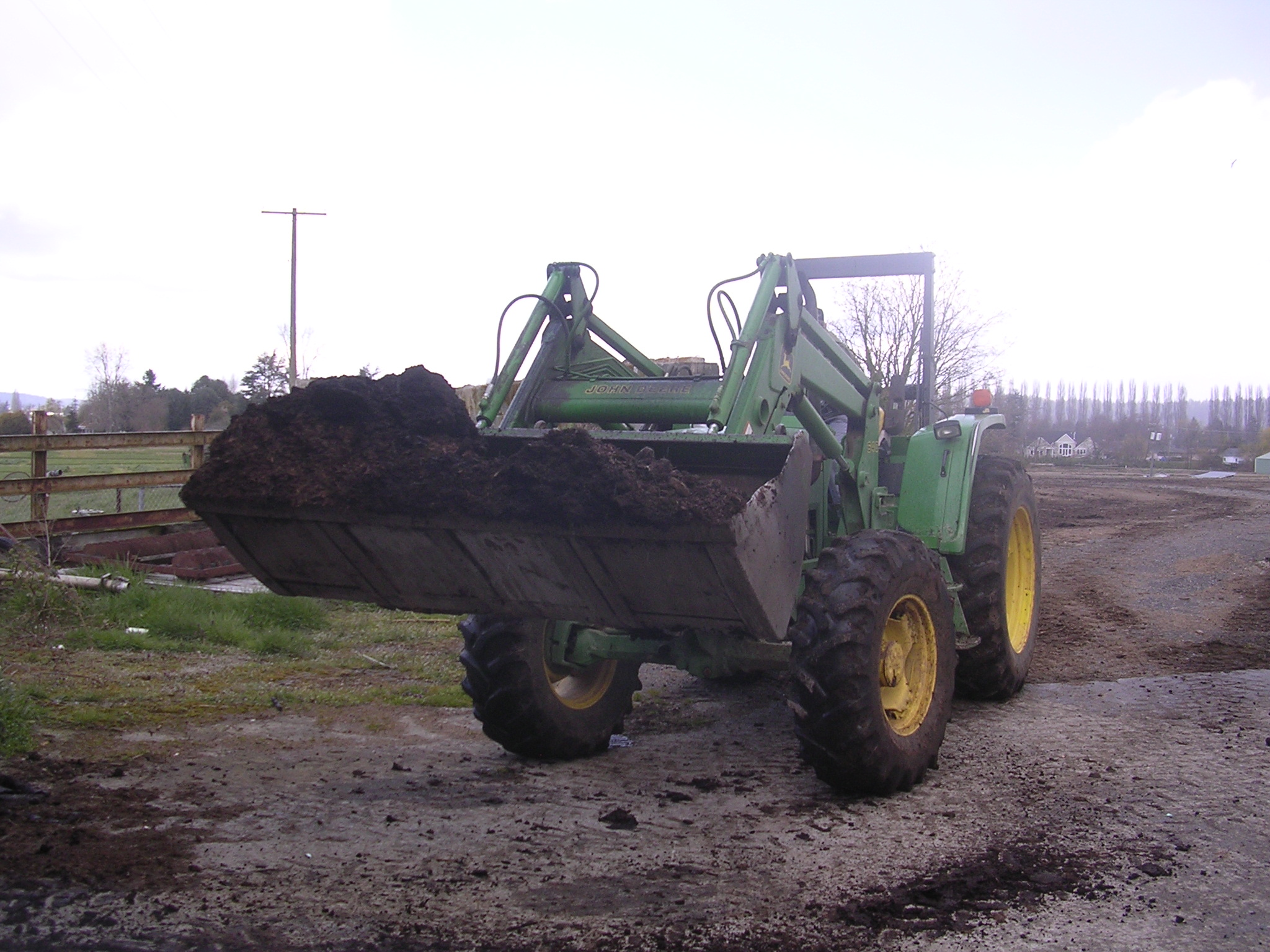 Tractor handling manure