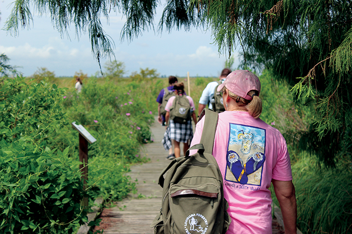 Participants walk through wetlands at Turtle Cove Environmental Research Station (Turtle Cove ERS) on Pass Manchac in southeastern Louisiana.