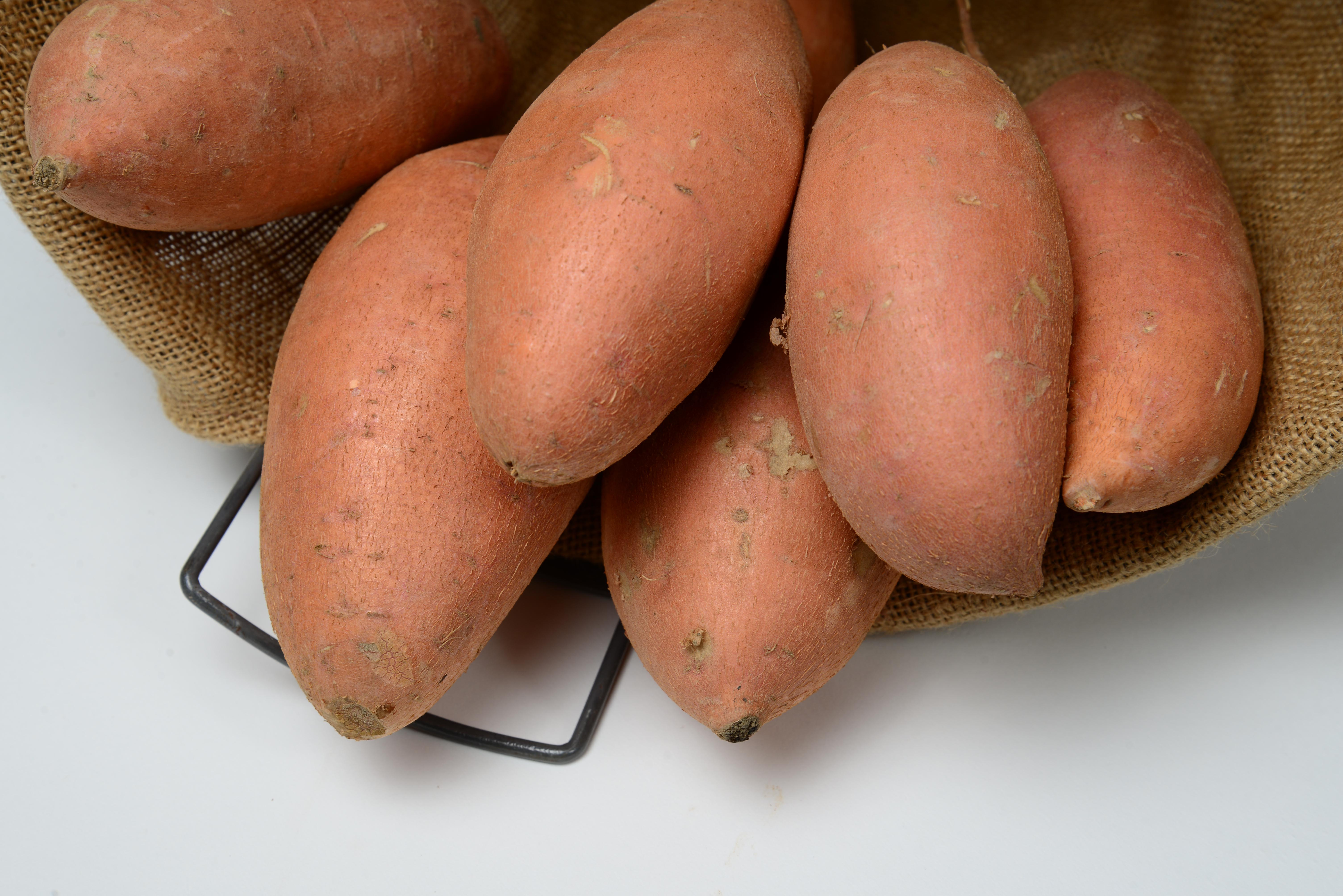 Orange skinned sweet potato in basket