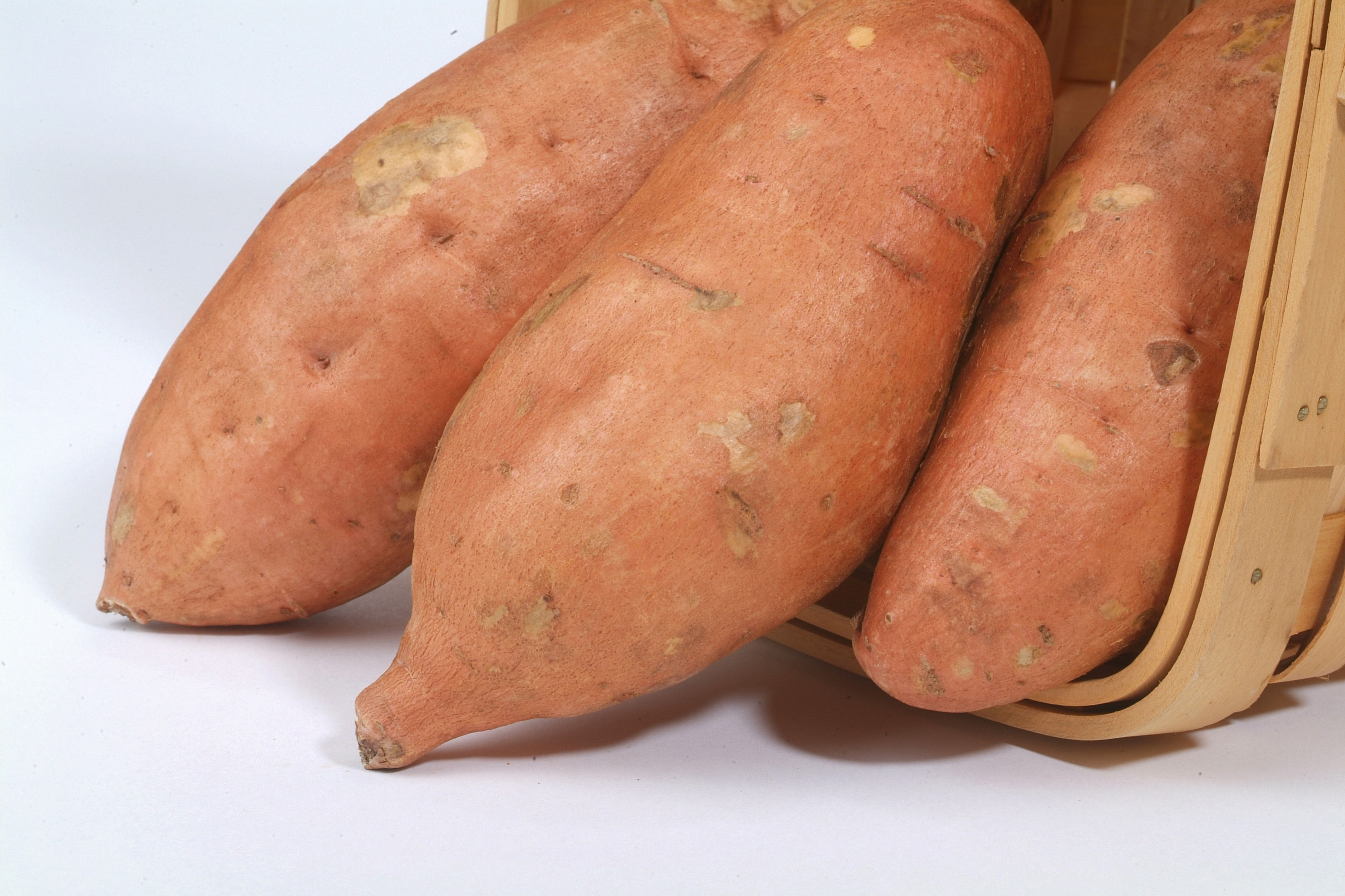 Orange skinned sweet potato in basket.