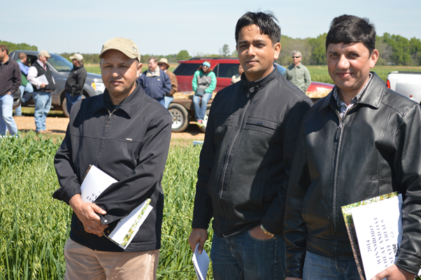 members participate in field tour.