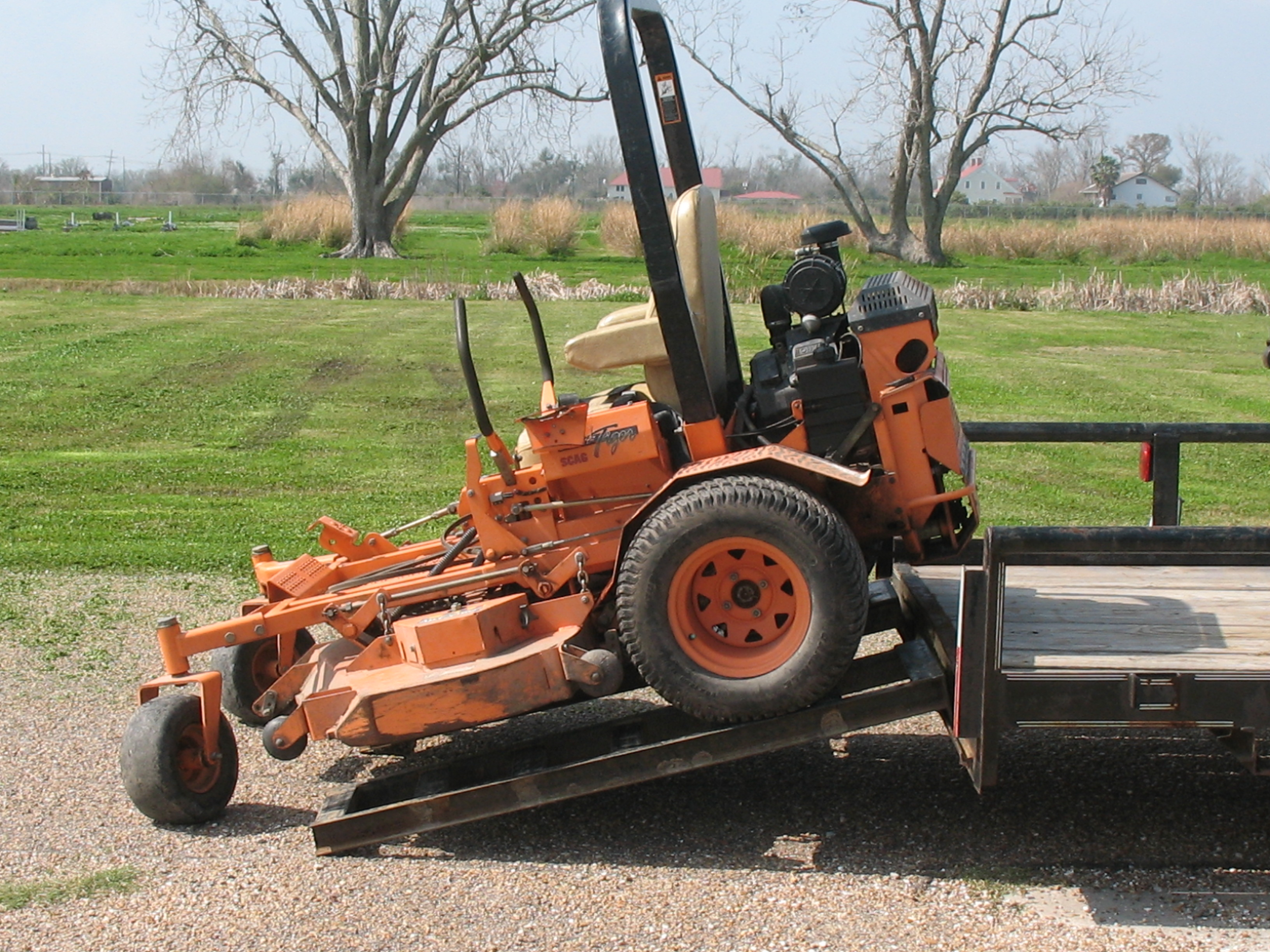 backing mower up ramps onto trailer