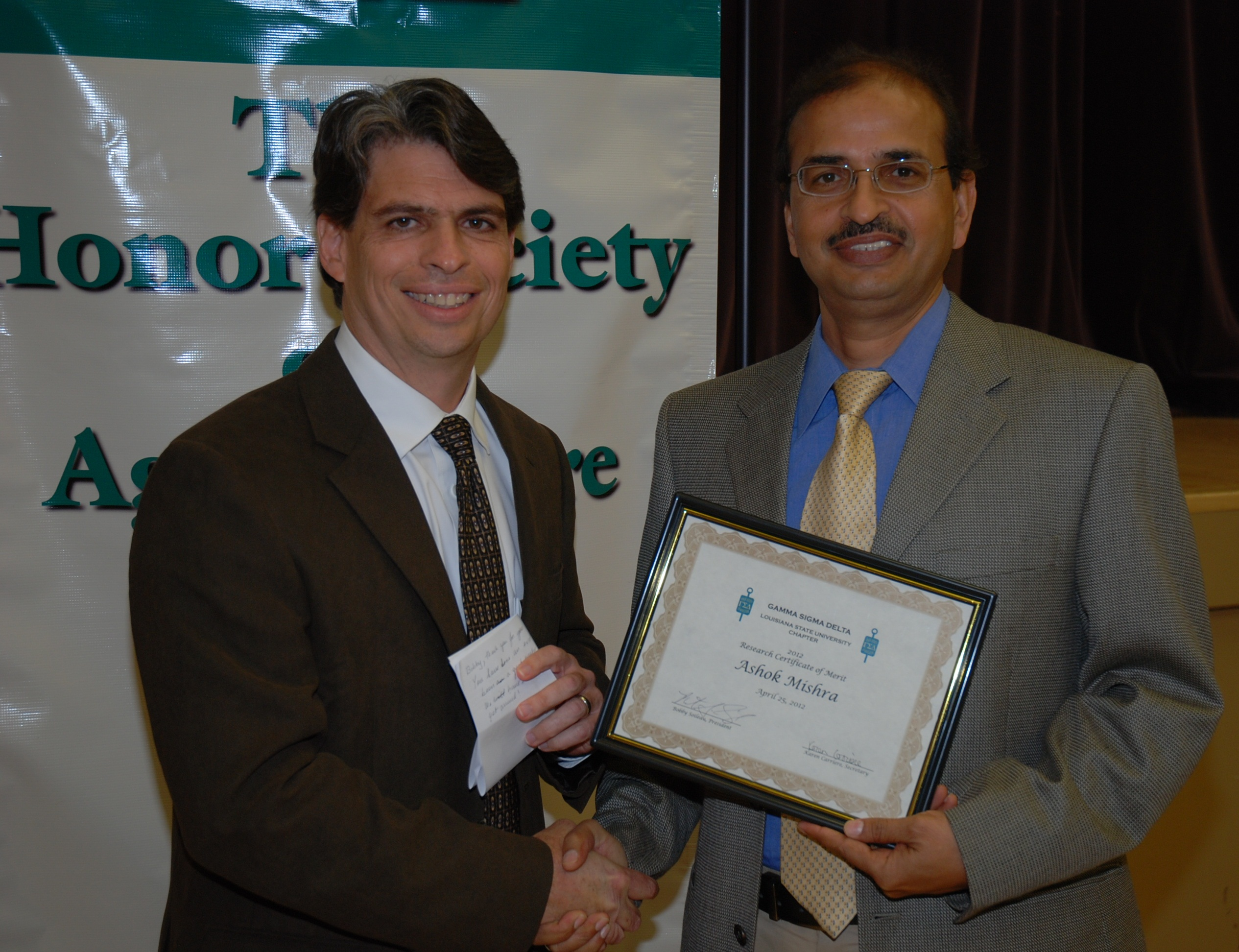 Mishra receives the Certificate of Merit.
