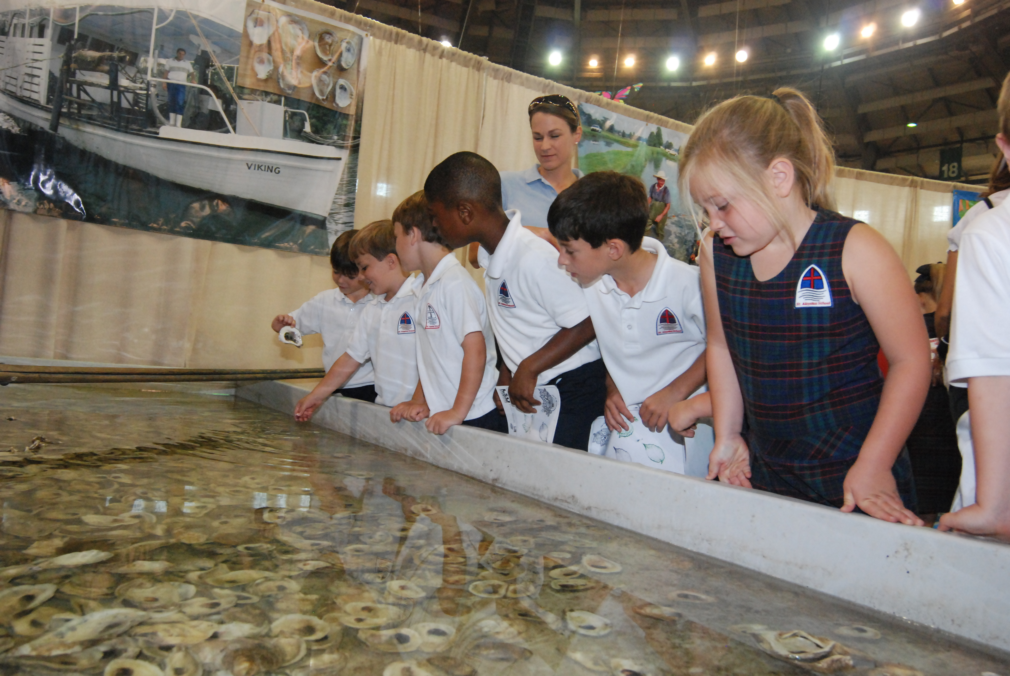 Farming Waters - group viewing aquaculture exhibits