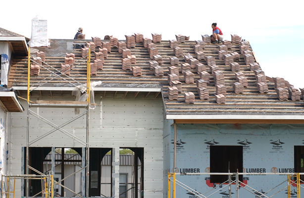 Photo of tile stacked on roof.