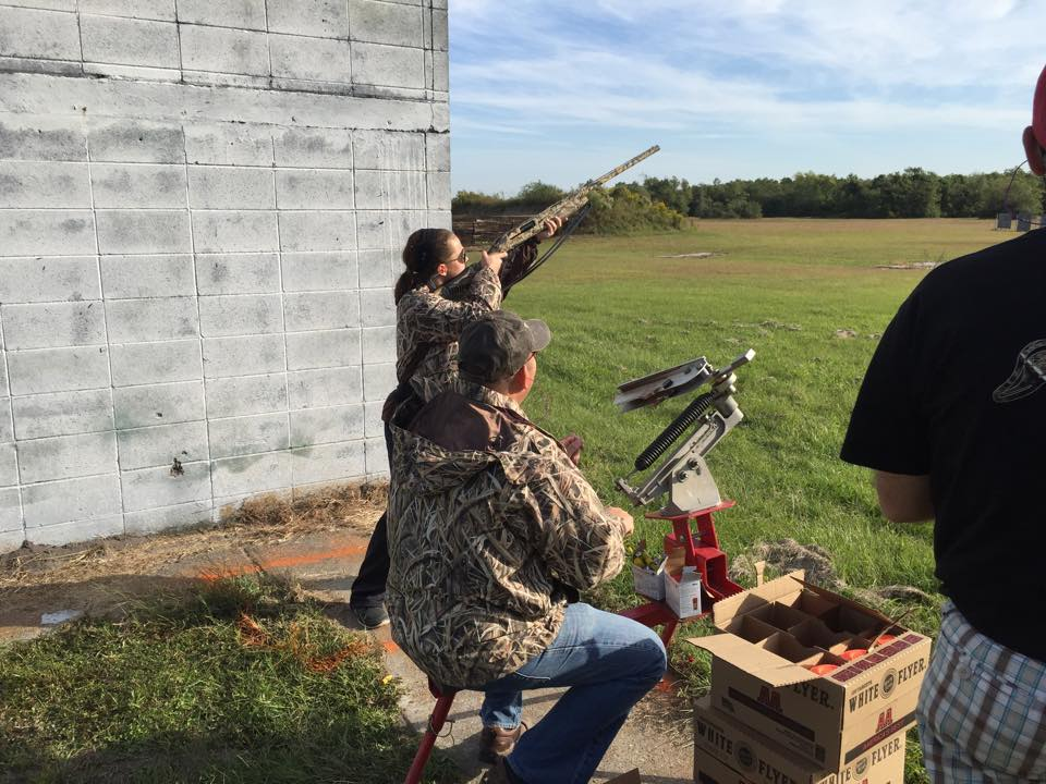 Picture of 4-H'ers participating in the shooting sports program.