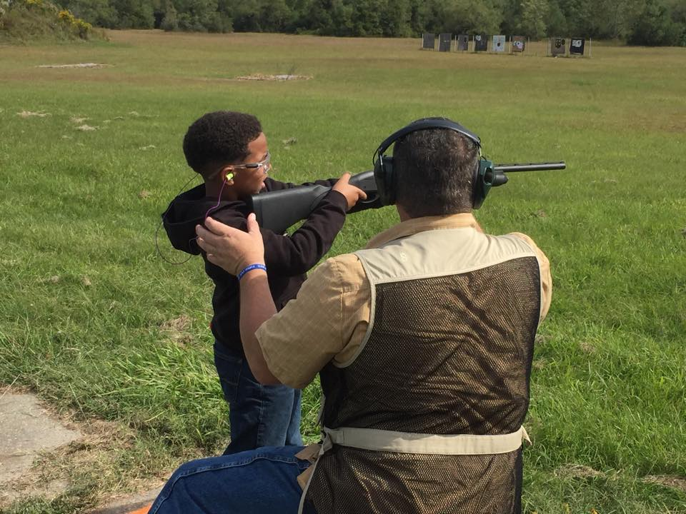 Picture of 4-H'er with shooting sports instructor.
