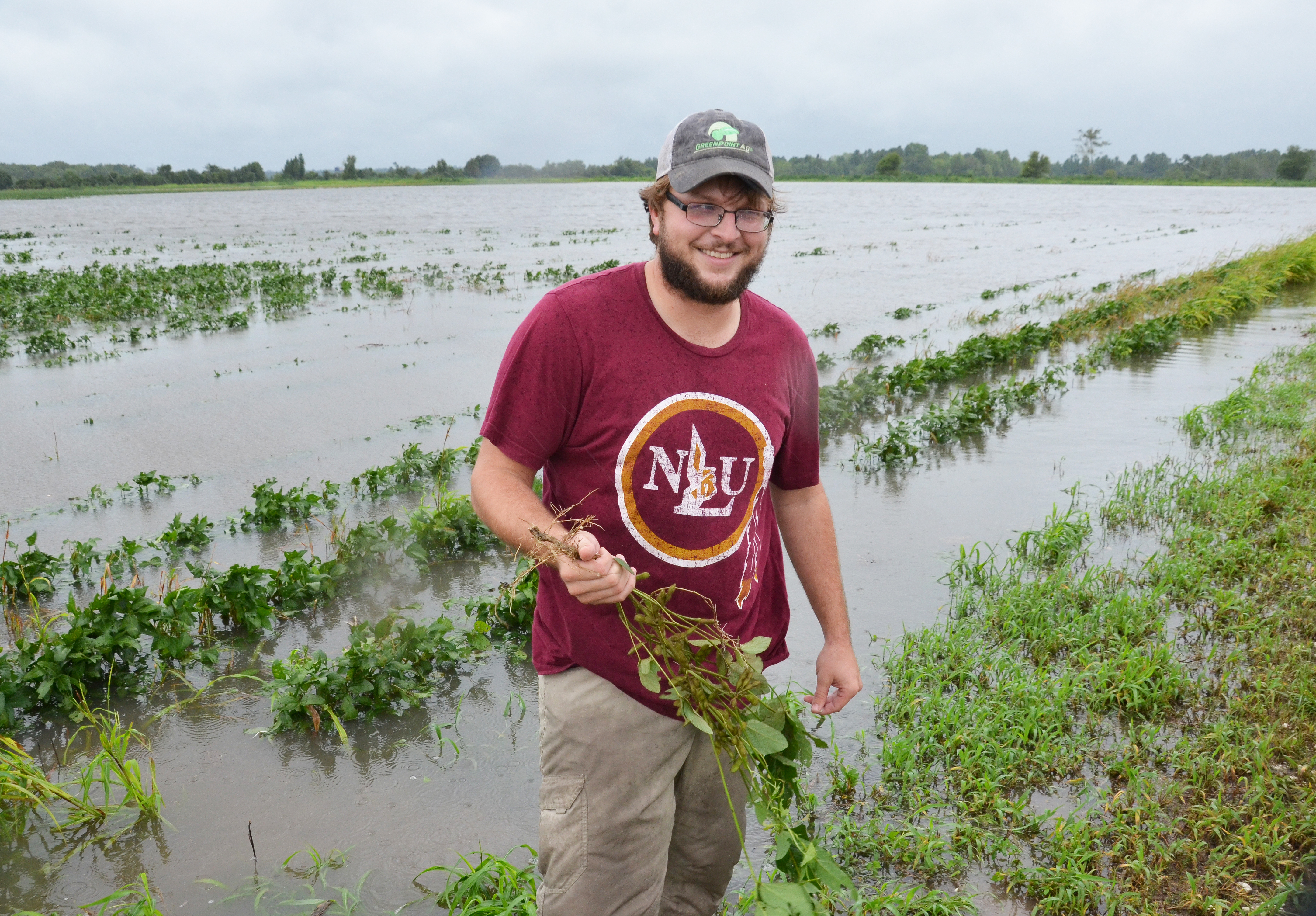 Josh Sikes with soybeans.jpg thumbnail