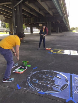 stenciling on pavement.jpg thumbnail