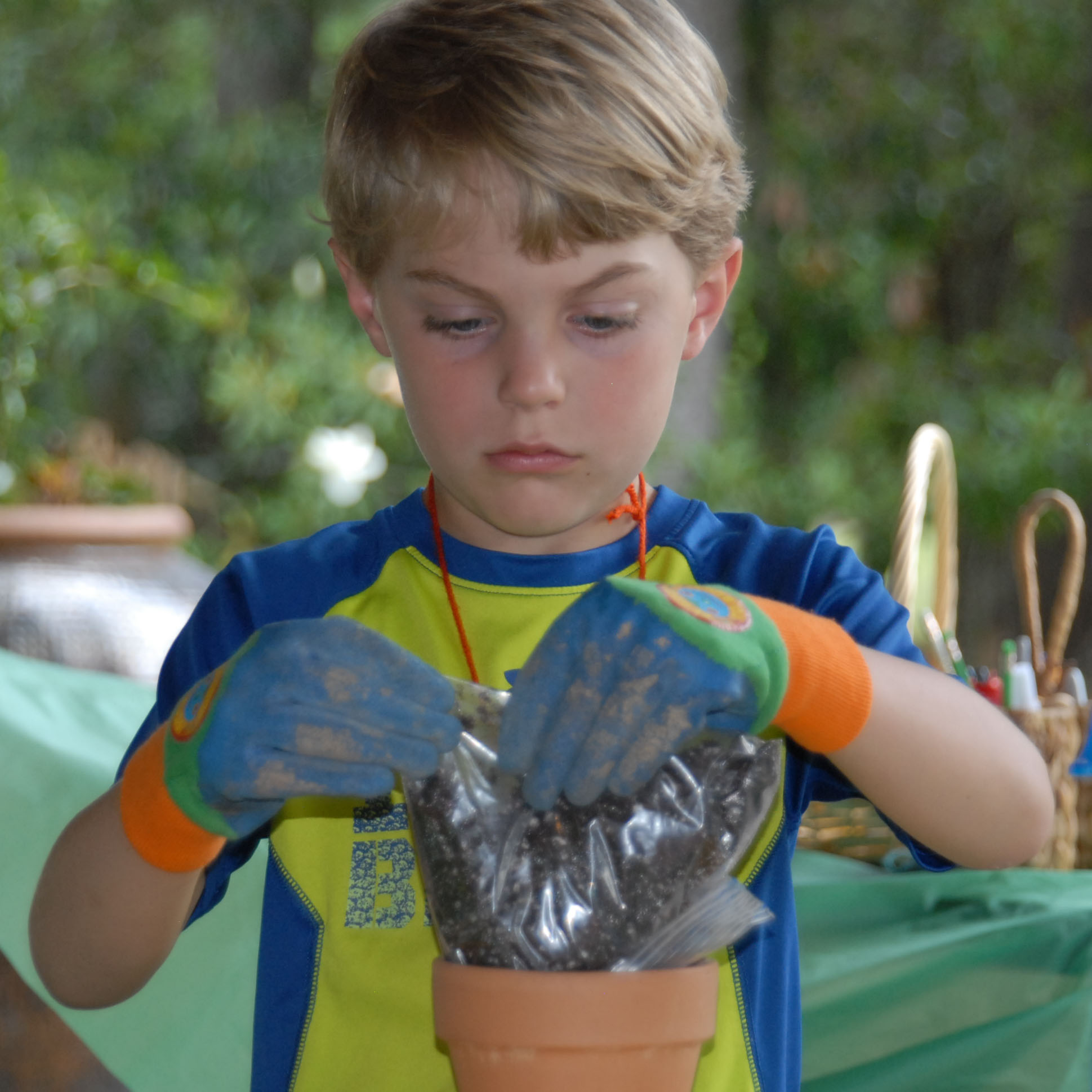 blond boy with clay pot.jpg thumbnail