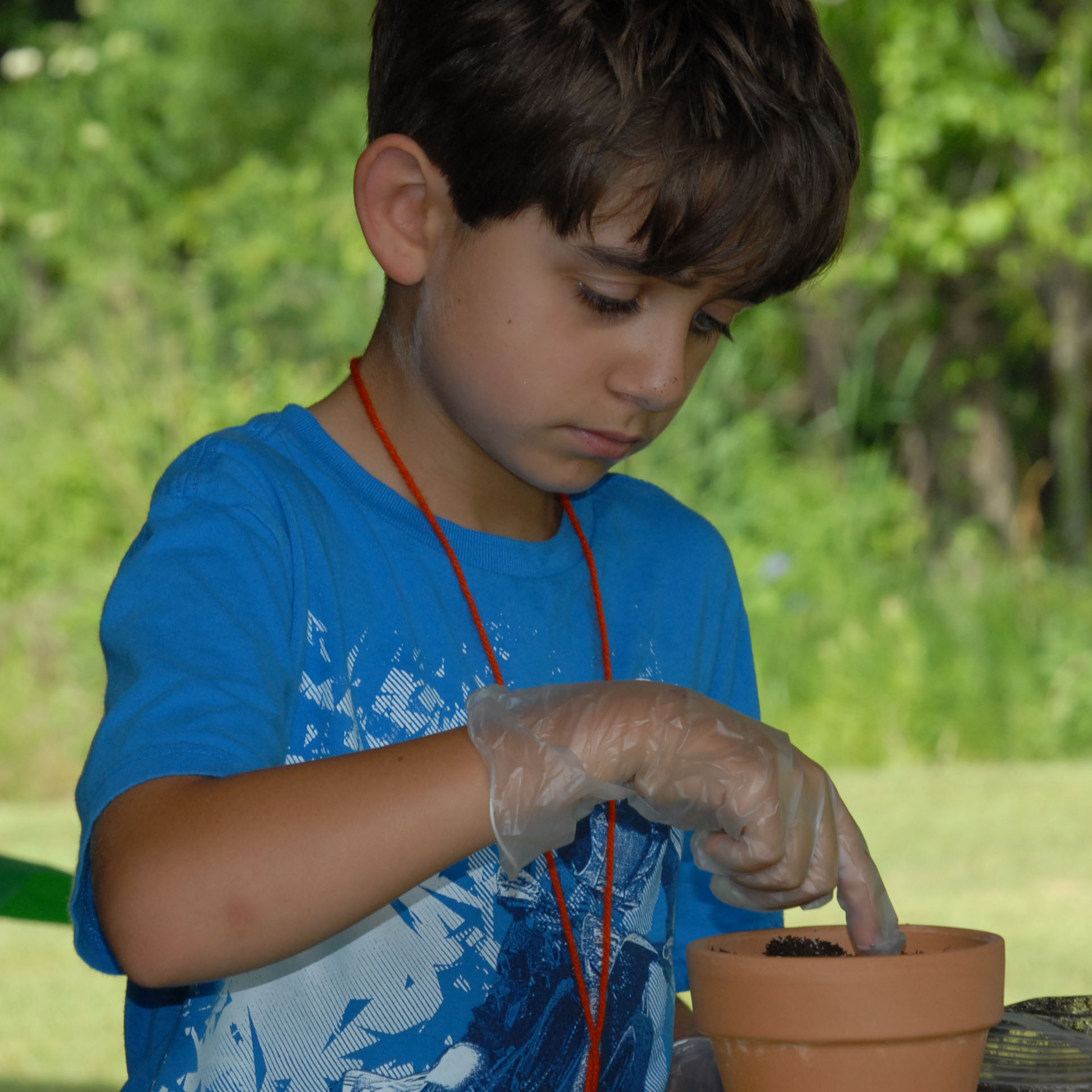 boy in blue with clay pot.jpg thumbnail