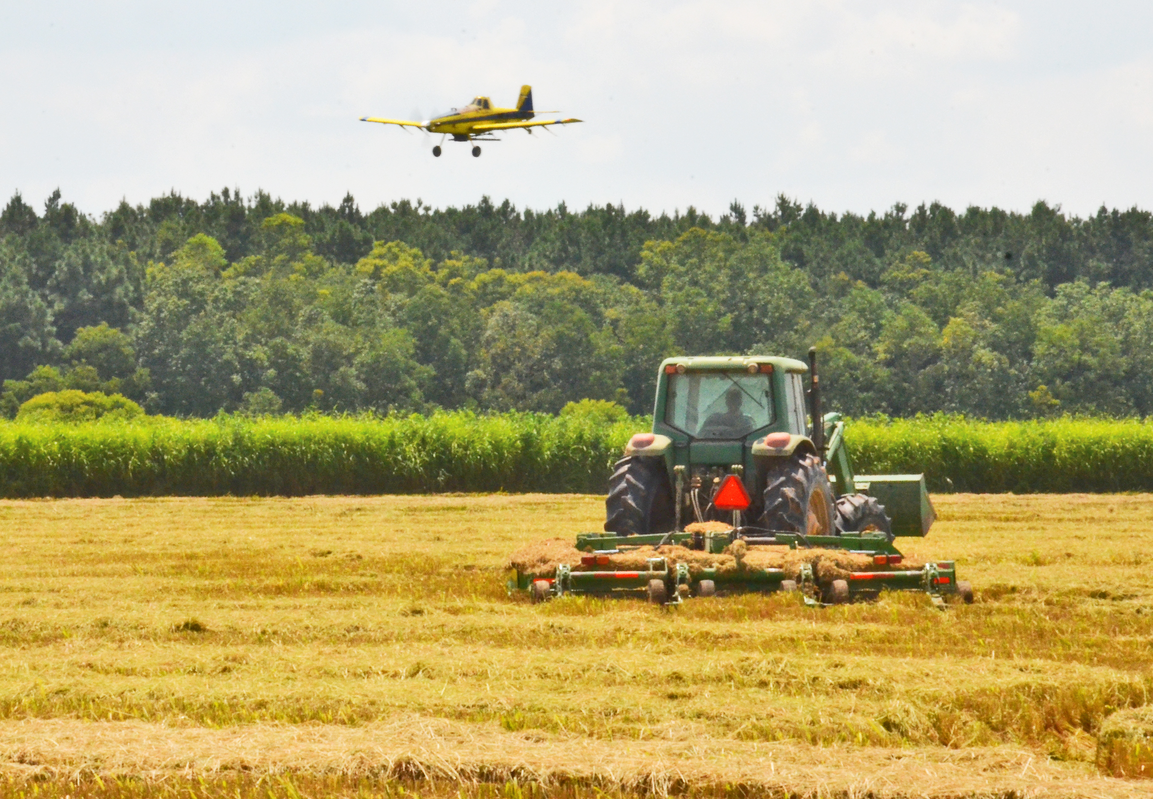 airplane flying fertilizer and tractor mowing stubble.jpg thumbnail