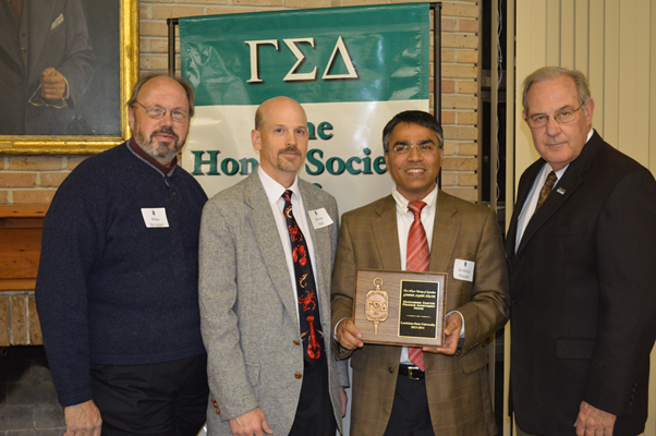 Brugger, Hall, Paudel and Richardson are seen with the Outstanding Chapter Award.
