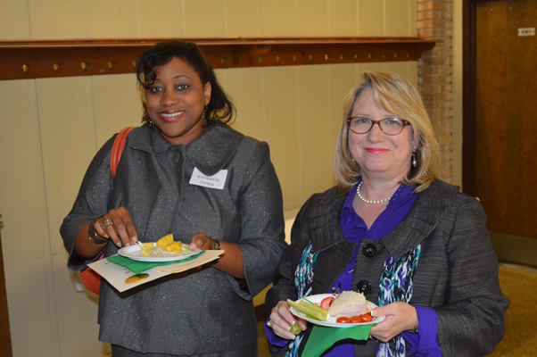 Kim Jones and Janet Fox enjoy refreshments served following the ceremony.
