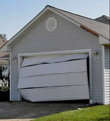 Garage door pulled out by wind.