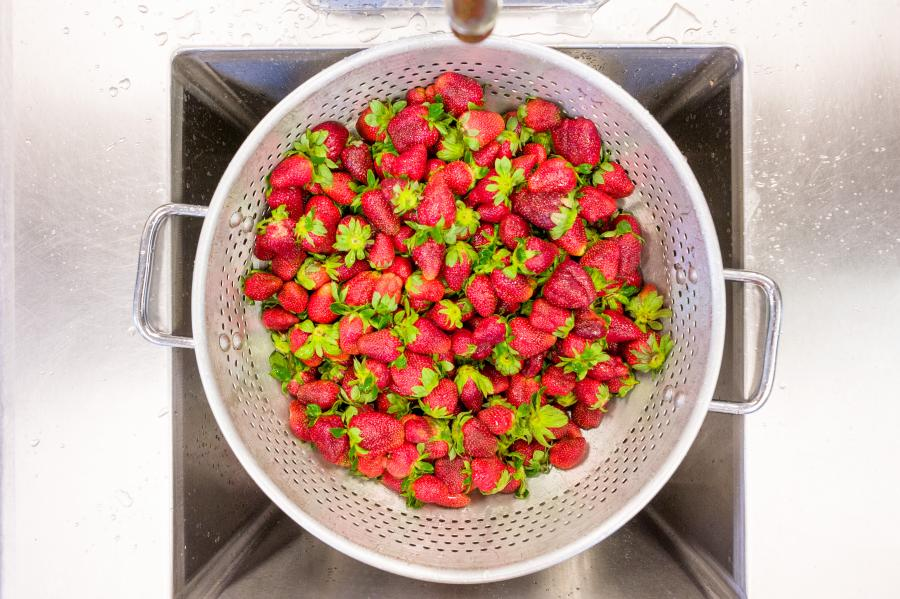 fresh strawberries in a strainer