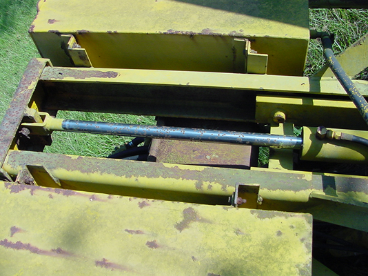 rusted and pitted hydraulic cylinder
