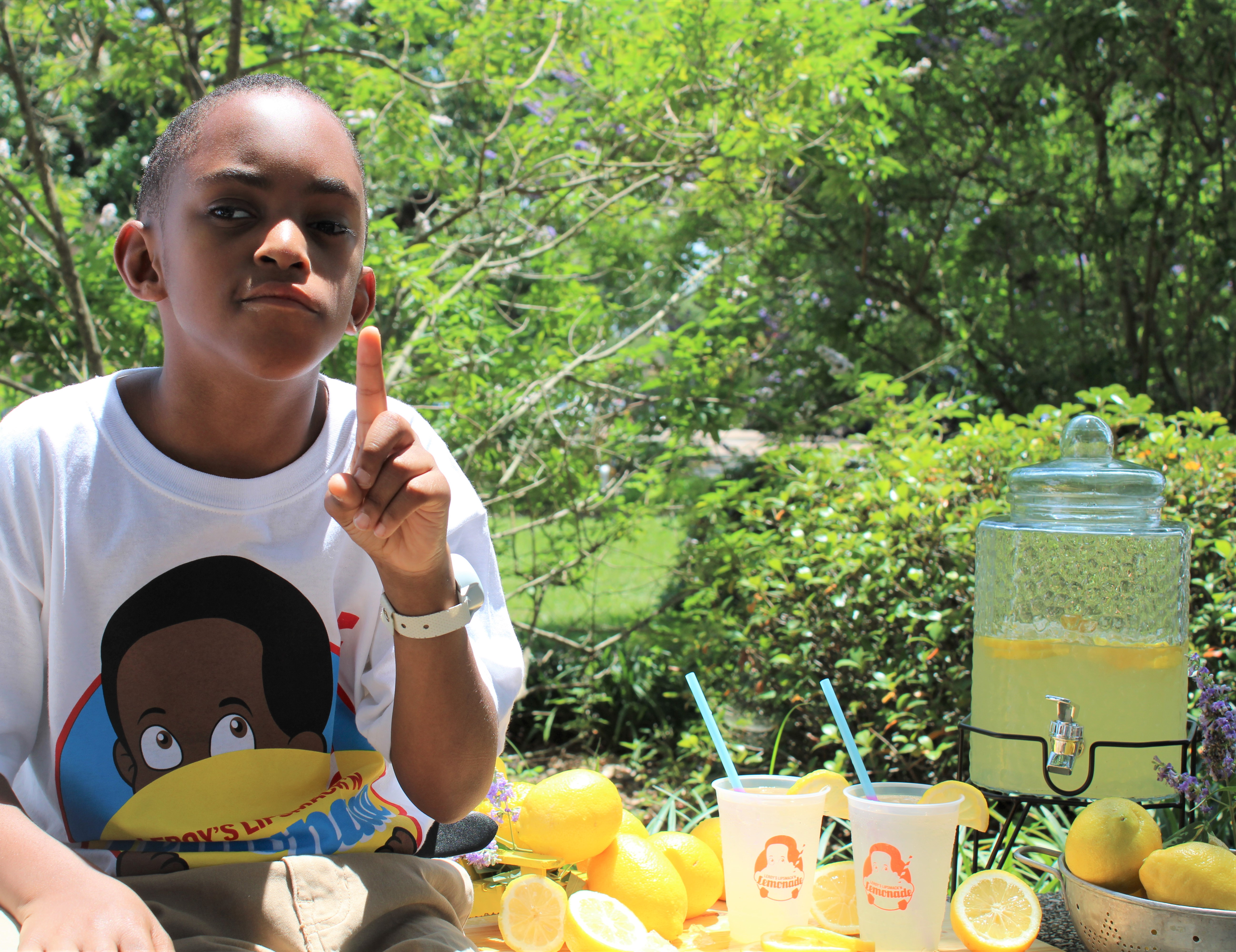 Boy sitting by lemonade.jpg thumbnail