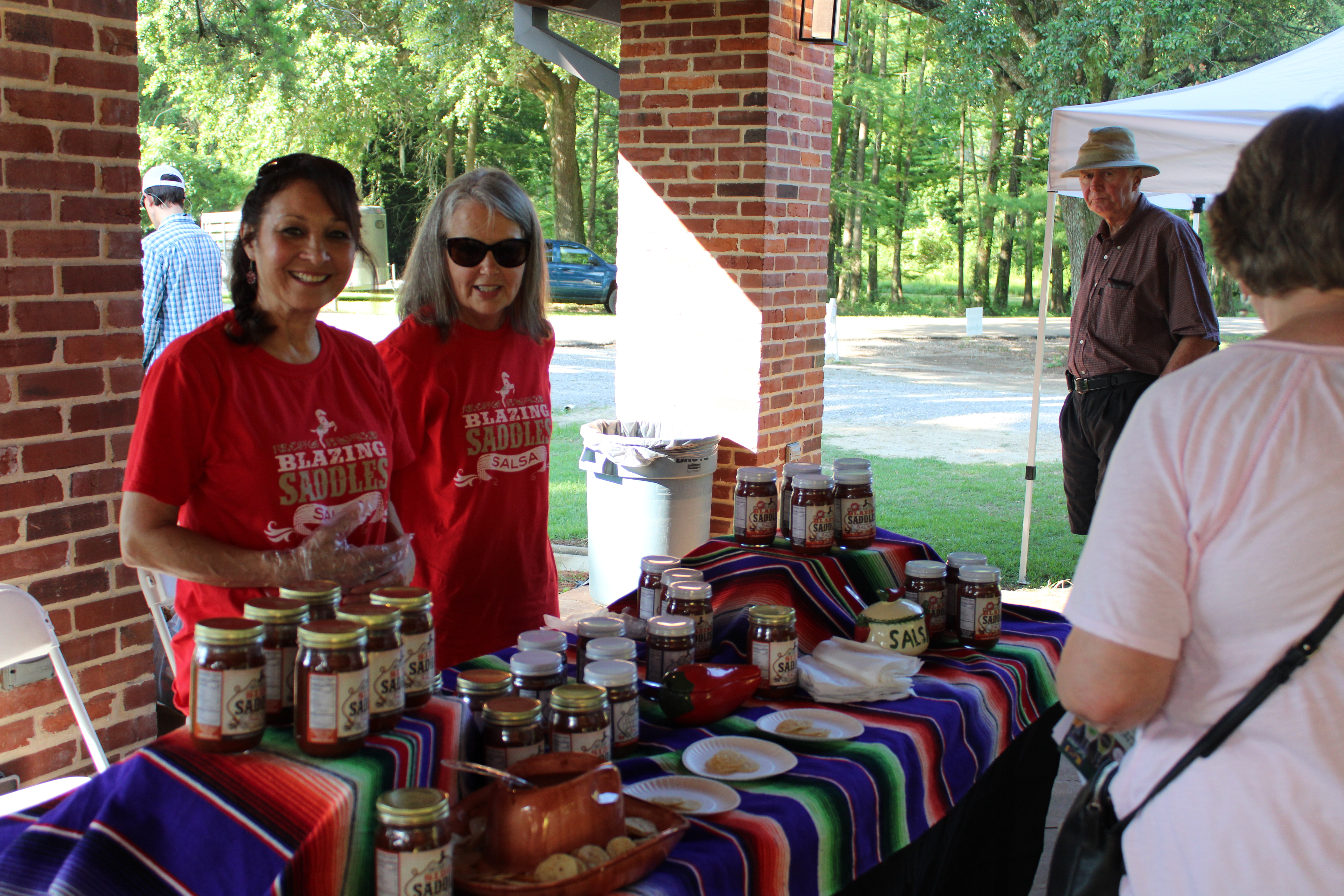 Landies behind salsa sample table.JPG thumbnail