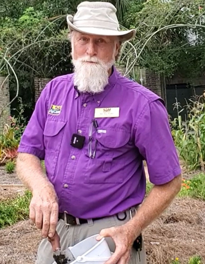 Joe Willis demonstrates taking a soil sample .jpg thumbnail