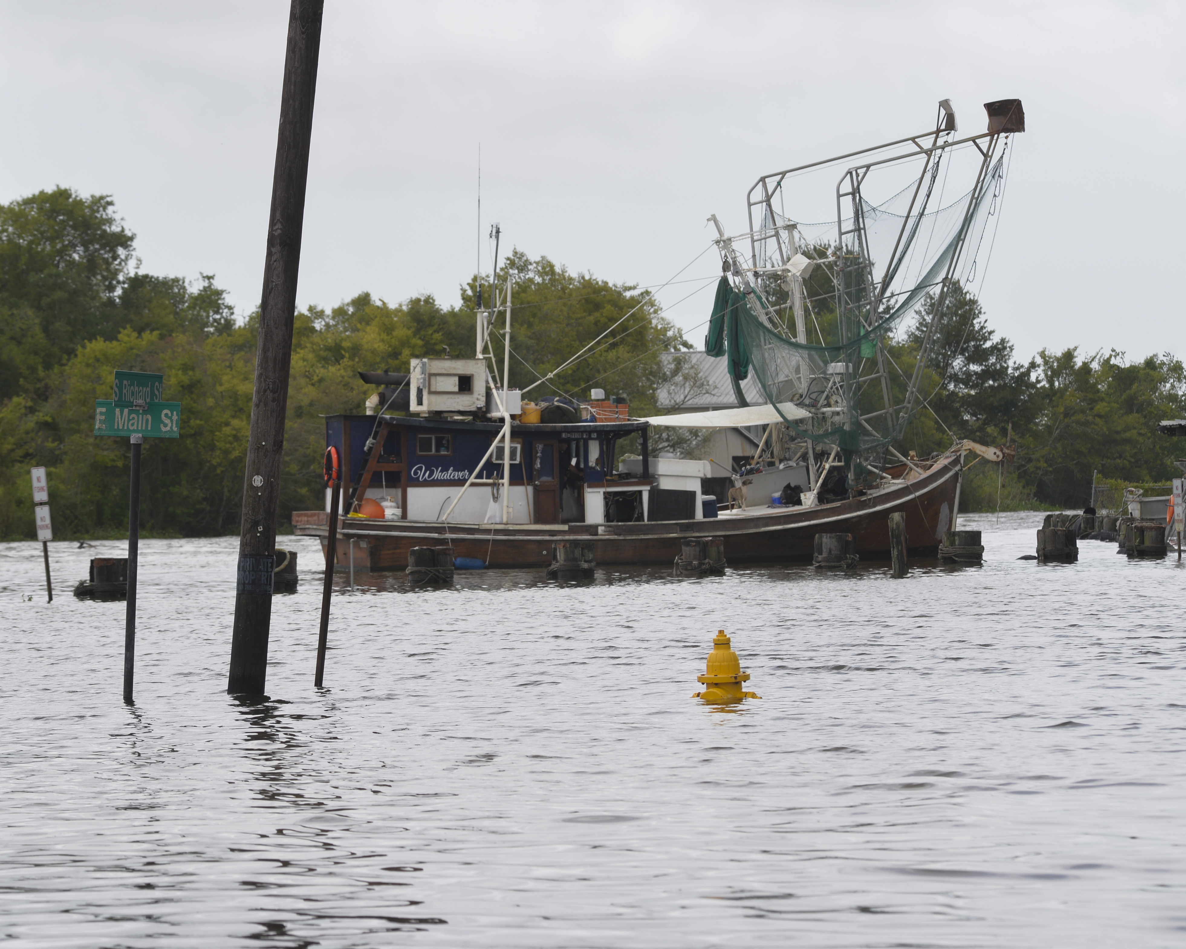 flooded town with a shrimp boat